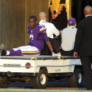 FILE - In this Sunday, Sept. 28, 2014, file photo, Minnesota Vikings quarterback Teddy Bridgewater is taken off the field on a cart after getting injured in the second half of an NFL football game against the Atlanta Falcons in Minneapolis. Bridgewater's first start for the Minnesota Vikings couldn't have been better, except of course for the sprained left ankle in the fourth quarter that forced him out of the 41-28 victory over Atlanta. (AP Photo/Jim Mone, File)
