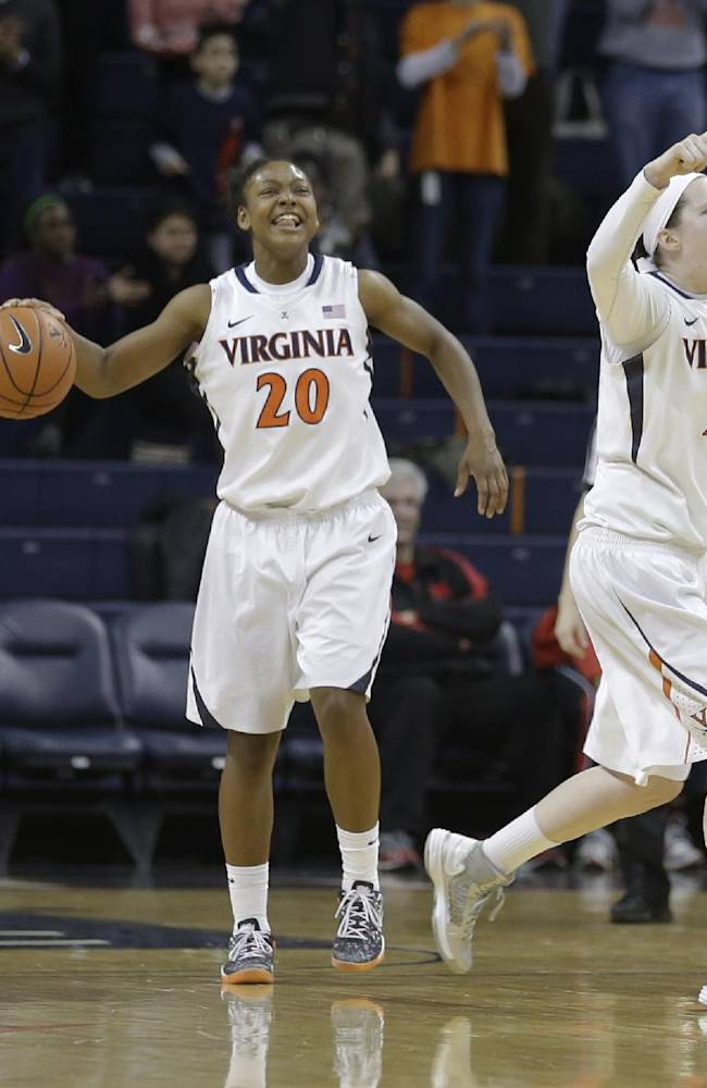 Virginia guard Ataira Franklin (23), guard Faith Randolph (20), and Lexie Gerson (14)  celebrate their win over Maryland during the second half of an NCAA college basketball game in Charlottesville, Va., Thursday, Jan. 23, 2014. Virginia won the game 86-72