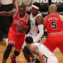 Apr 29, 2013; Brooklyn, NY, USA; Chicago Bulls small forward Luol Deng (9) drives around Brooklyn Nets small forward Gerald Wallace (45) during the first quarter in game five of the first round of the 2013 NBA playoffs at the Barclays Center. (Anthony Gruppuso-USA TODAY Sports)