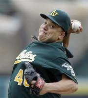 Oakland Athletics starter Bartolo Colon pitches to the Los Angeles Angels in the first inning of a baseball game in Anaheim, Calif., Sunday, July 21, 2013. (AP Photo/Reed Saxon)