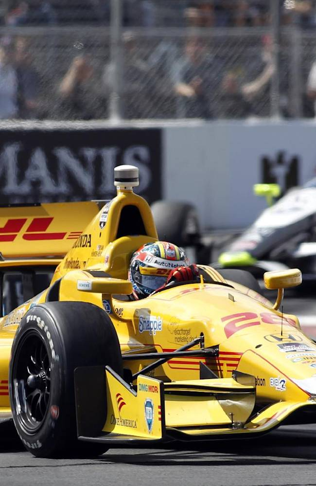 Ryan Hunter-Reay (28) leads the pack with James Hinchcliffe, left, and Josef Newgarden, right, coming out of a caution period during the IndyCar Grand Prix of Long Beach auto race on Sunday, April 13, 2014, in Long Beach, Calif. Later in the race, Newgarden was leading Hunter-Reay, who tried to make a pass in Turn 4. The two cars collided, Newgarden was sent into the wall and Hunter-Reay bounced into Helio Castroneves' path