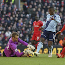 Liverpool's Simon Mignolet, left, stops a shot by West Ham United's Enner Valencia, centre, as Liverpool's Emre Can closes in during their English Premier League match at Anfield, Liverpool England, Saturday Jan. 31, 2015