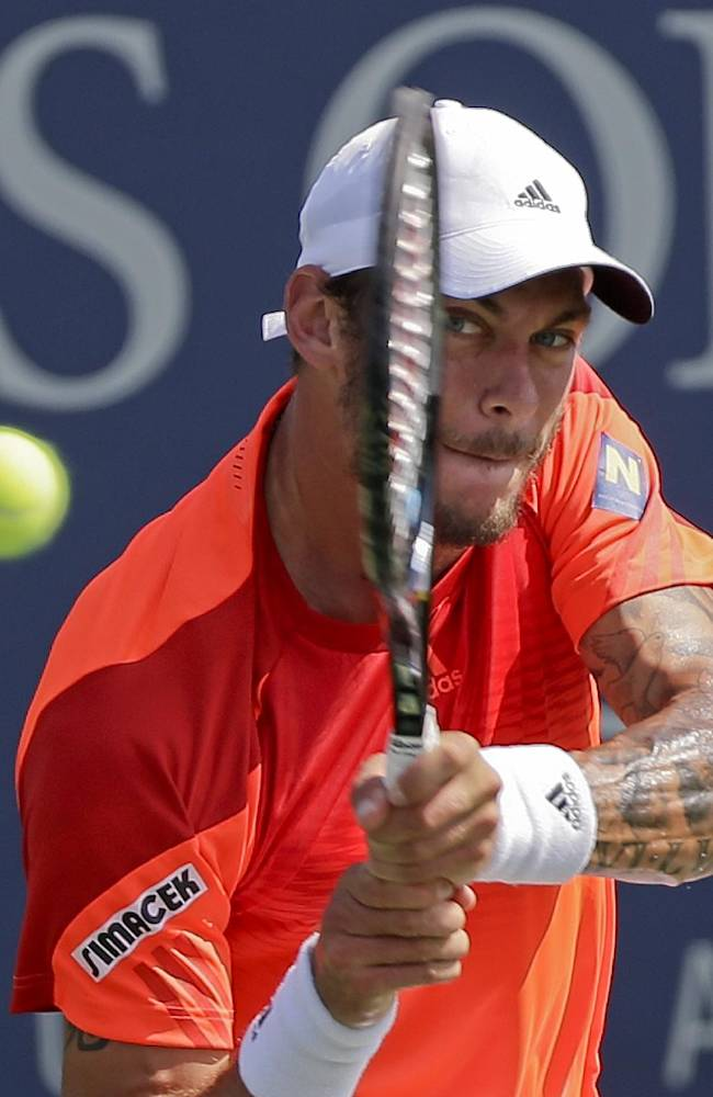 Andreas Haider-Maurer, of Austria, returns a shot against Roberto Bautista Agut, of Spain, during the first round of the 2014 U.S. Open tennis tournament, Tuesday, Aug. 26, 2014, in New York