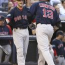 Boston Red Sox's Carl Crawford, right, is greeted by teammate Dustin Pedroia after hitting a home run during the third inning of the baseball game against the New York Yankees at Yankee Stadium in New York, Friday, July 27, 2012. (AP Photo/Seth Wenig)