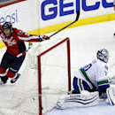Washington Capitals center Brooks Laich (21) celebrates his goal past Vancouver Canucks goalie Ryan Miller (30) in the third period of an NHL hockey game, Tuesday, Dec. 2, 2014, in Washington. The Canucks won 4-3 The Associated Press