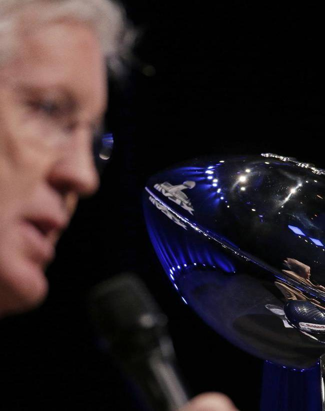 Seattle Seahawks head coach Pete Carroll speaks at a news conference Friday, Jan. 31, 2014, in New York as he sits next to the Vince Lombardi Trophy. The Seahawks are scheduled to play the Denver Broncos in the NFL Super Bowl XLVIII football game on Sunday, Feb. 2, at MetLife Stadium in East Rutherford, N.J