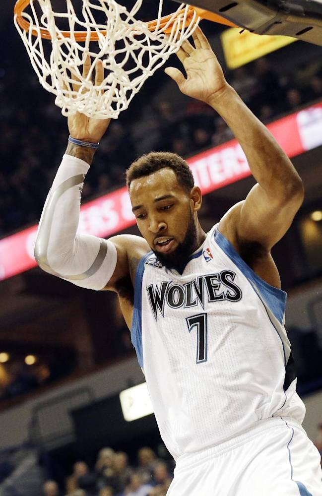 In this Nov. 1, 2013 file photo, Minnesota Timberwolves' Derrick Williams dunks in the first half of an NBA basketball game against the Oklahoma City Thunder, in Minneapolis. The Timberwolves have finalized the trade that sends Williams to Sacramento for Luc Mbah a Moute. The deal was finished on Tuesday, Nov. 26, 2013