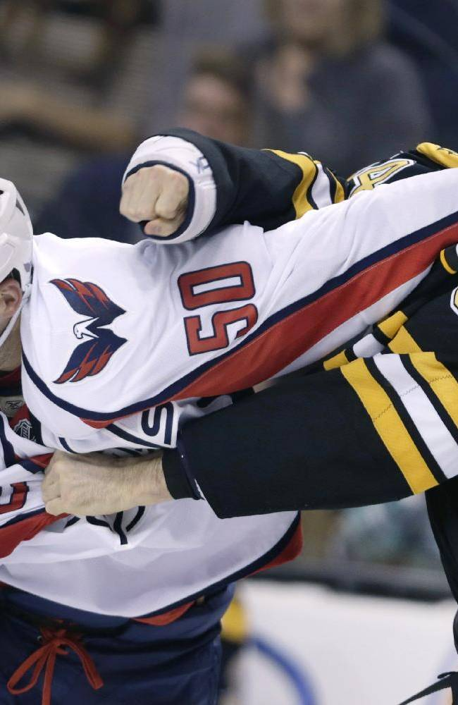 Washington Capitals left wing Dane Byers (50) tries to duck a punch from Boston Bruins defenseman Adam McQuaid (54) in the third period of an NHL preseason hockey game, Monday, Sept. 23, 2013, in Boston. The Bruins defeated the Capitals 3-2 in overtime