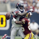 Washington Redskins' Bashaud Breeland (26) breaks up a pass intended for Houston Texans' Andre Johnson (80) during the first quarter of an NFL football game Sunday, Sept. 7, 2014, in Houston The Associated Press