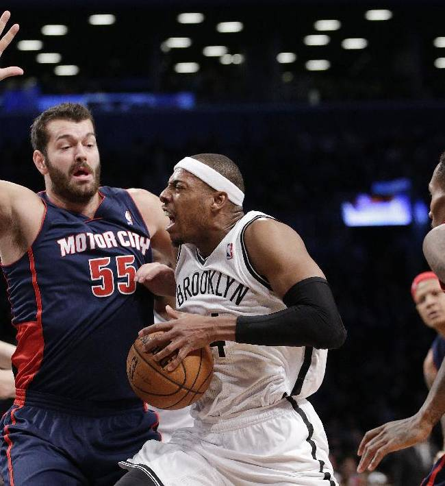 Brooklyn Nets forward Paul Pierce, center, is guarded by Detroit Pistons forward Josh Harrellson (55) during the first half of an NBA basketball game, Sunday, Nov. 24, 2013, in New York