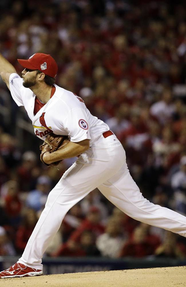St. Louis Cardinals starting pitcher Adam Wainwright throws during the first inning of Game 5 of baseball's World Series against the Boston Red Sox Monday, Oct. 28, 2013, in St. Louis