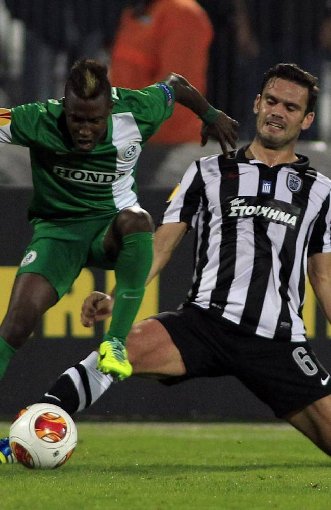 PAOK's Alexandros Tziolis, right, and Maccabi Haifa's Taleb Twatha, fight for the ball during their Europa League Group L soccer match at the Toumba stadium in the northern Greek port city of Thessaloniki, Thursday, Oct. 24, 2013