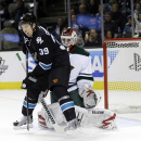 San Jose Sharks' Logan Couture (39) get a pas in front of Minnesota Wild goalie Niklas Backstrom, of Finland, during the first period of an NHL hockey game on Thursday, Dec. 12, 2013, in San Jose, Calif The Associated Press