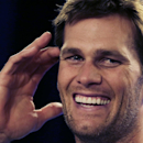 New England Patriots quarterback Tom Brady laughs during a news conference prior to an NFL football practice in Foxborough, Mass., Wednesday, Dec. 17, 2014 The Associated Press