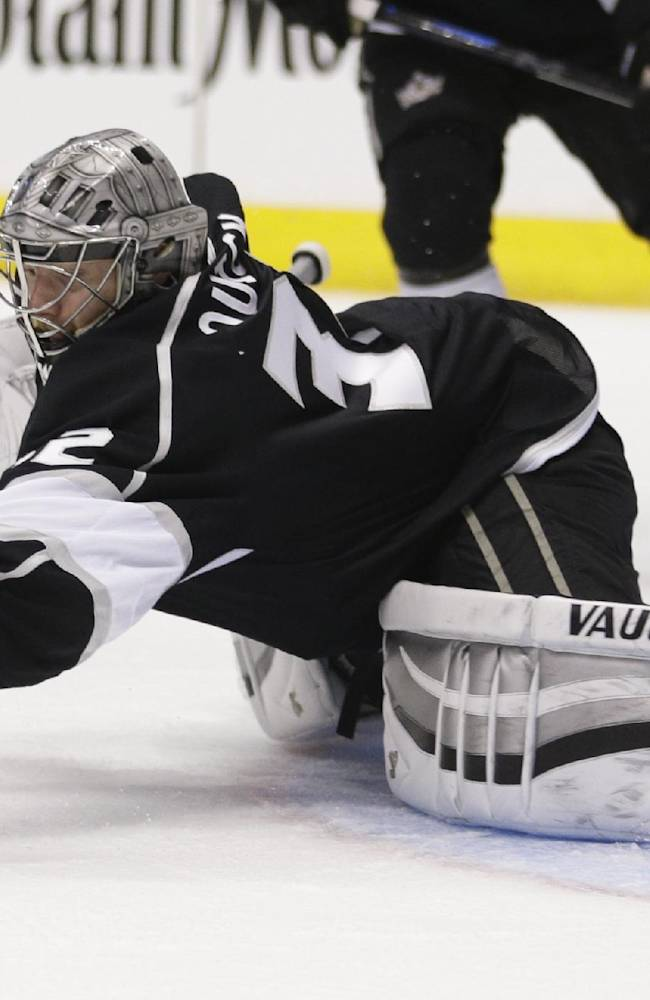 Los Angeles Kings goalie Jonathan Quick grabs the puck while playing the New York Rangers during the first period in Game 5 of the NHL Stanley Cup Final series Friday, June 13, 2014, in Los Angeles