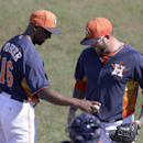 Houston Astros manager Bo Porter, left, gives relief pitcher Peter Moylan the ball after their 4-3 win over the Toronto Blue Jays during a spring training baseball game in Kissimmee, Fla., Sunday, March 9, 2014 The Associated Press