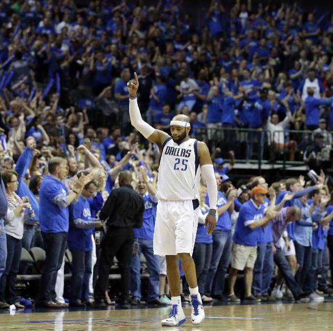 Fans erupt from their chairs as Dallas Mavericks' Vince Carter (25) celebrates a basket by his team late in the second half of Game 6 of an NBA basketball first-round playoff series against the San Antonio Spurs, Friday, May 2, 2014, in Dallas. The Mavericks won 113-111