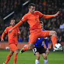 In this March 22, 2013, file photo, Robin van Persie of The Netherlands scores 2-0 during the Group D world cup qualifying soccer match Netherlands against Estonia in Amsterdam, Netherlands. Robin van Persie and Arjen Robben continue to spark the Oranje,