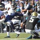 San Diego Chargers free safety Eric Weddle is upended by Jacksonville Jaguars quarterback Blake Bortles after intercepting a Bortles pass during the second half of an NFL football game Sunday, Sept. 28, 2014, in San Diego. Bortles was penalized for trippi