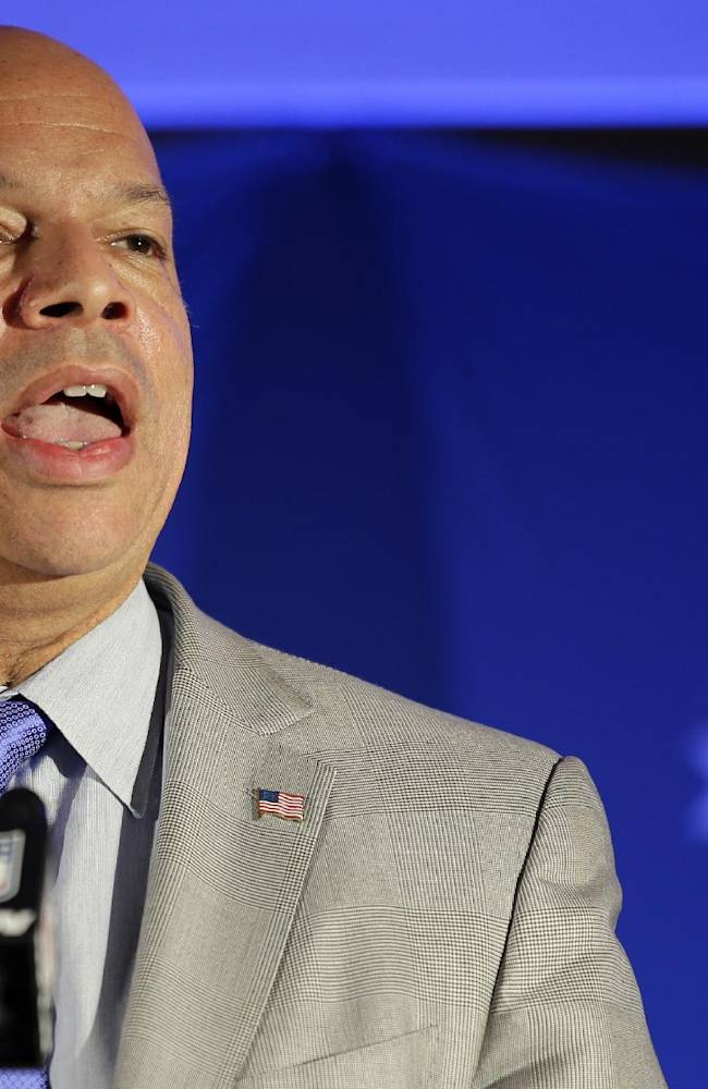 Jeh Johnson, with the Department of Homeland Security, speaks during a security news conference at the NFL Super Bowl XLVIII media center, Wednesday, Jan. 29, 2014, in New York