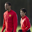 Manchester United's Shinji Kagawa, right, and Rio Ferdinand train with teammates at Carrington training ground in Manchester, Monday, Dec. 9, 2013. Manchester United will play Shakhtar Donetsk in a Champion's League Group A soccer match on Tuesday