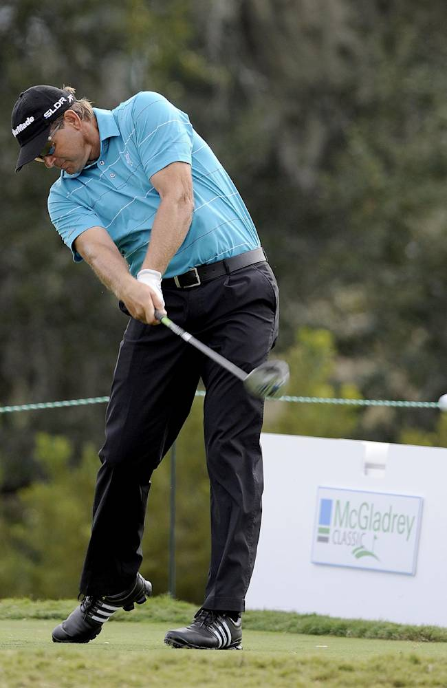 Retief Goosen, of South Africa, tees of on the 11th hole during the final round of the McGladrey Classic golf tournament on Sunday, Nov. 10, 2013, in St. Simons Island, Ga