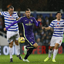 Manchester City's Edin Dzeko, center, vies for the ball with QPR's Richard Dunne, left, and Joey Barton during the English Premier League soccer match between Queens Park Rangers and Manchester City at Loftus Road stadium in London, Saturday, Nov. 8, 2014