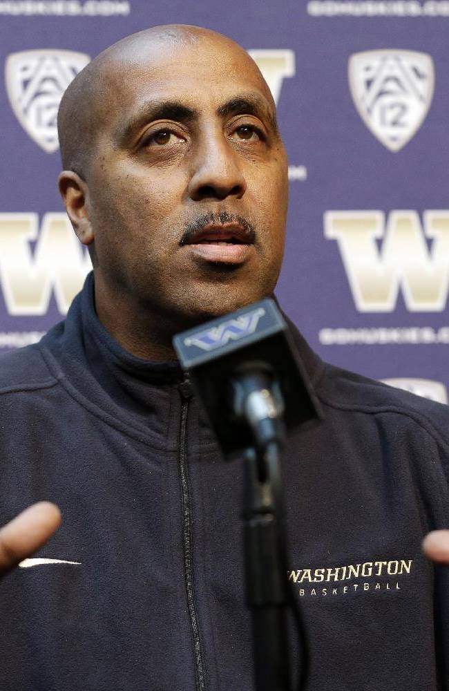 Washington head coach Lorenzo Romar speaks at a media day news conference Tuesday, Oct. 8, 2013, in Seattle. Romar spent the offseason retooling Washington after two straight seasons without making the NCAA tournament