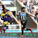 Newcastle United's Paul Dummett, right, vies for the ball with Swansea City's Jonathan De Guzman, left, during their English Premier League soccer match at St James' Park, Newcastle, England, Saturday, April 19, 2014