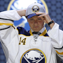 Sam Reinhart pulls on a Buffalo Sabres hat after being chosen second overall during the first round of the NHL hockey draft, Friday, June 27, 2014, in Philadelphia The Associated Press