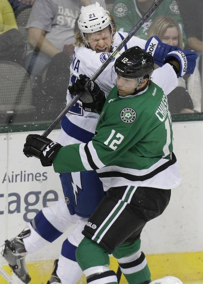 Tampa Bay Lightning defenseman Mike Kostka (21) is hit hard by Dallas Stars right wing Alex Chiasson (12) during the first period of an NHL hockey game Saturday, March 1, 2014, in Dallas