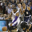 Sacramento Kings guard Marcus Thornton, left, scrambles for the ball against Oklahoma City Thunder guard Russell Westbrook during the third quarter of an NBA basketball game in Sacramento, Calif., Tuesday, Dec. 3, 2013. The Thunder won 97-95 The Associat