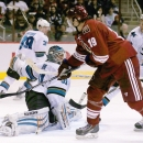 Arizona Coyotes' Shane Doan (19) scores a goal against San Jose Sharks' Antti Niemi, left, of Finland, as Sharks' Joe Pavelski, right, and Justin Braun, second from right, defend and Logan Couture (39) looks back during the second period of an NHL hockey