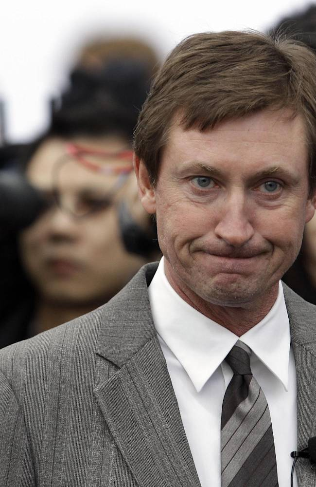 This is a Feb. 10, 2010 file photo showing hockey great Wayne Gretzky during an event at the Olympic Games in Vancouver, British Columbia. Two new statues of  Gretzky have been vandalized in his hometown. Police in Brantford, Ontario, say they are studying a videotape sent to them of Monday's, Sept. 30, 2013, overnight vandalism, which involved defacing the statues with spray paint