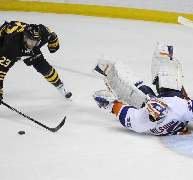 Buffalo Sabres' Ville Leino (23), of Finland, reacts after New York Islanders' Anders Nilsson (45), of Sweden, makes a save to preserve the win during a team shootout in an NHL hockey game in Buffalo, N.Y., Sunday, April 13, 2014.  The Islanders won 4-3