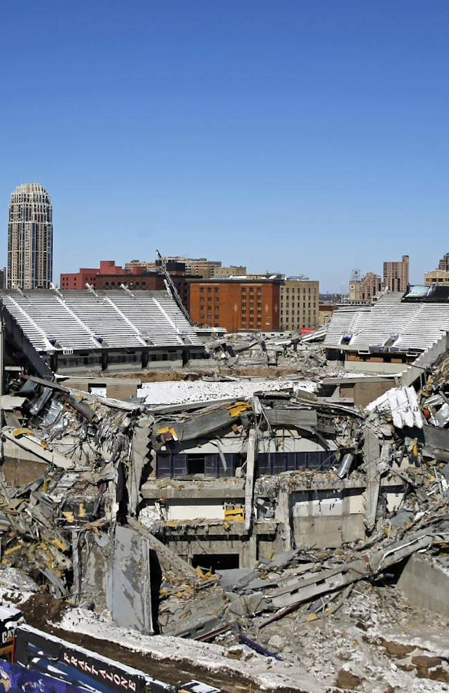 Part of the Metrodome is destroyed Sunday, Feb. 23, 2014, in Minneapolis. Crews are planning to use controlled explosive charges as they continue to demolish the roof structure of the Metrodome