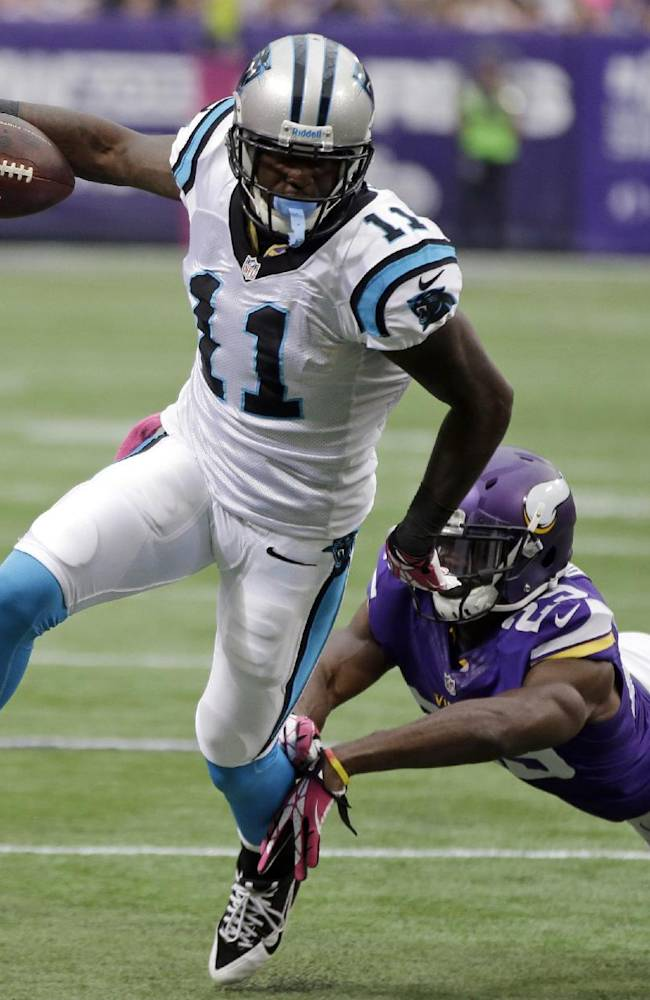 In this Oct. 13, 2013, file photo, Carolina Panthers wide receiver Brandon LaFell, left, breaks the tackle of Minnesota Vikings cornerback Xavier Rhodes on his way to the 1-yard line during the first half of an NFL football game in Minneapolis. . In Carolina's two wins this year, LaFell has seven catches for 160 yards and three touchdowns