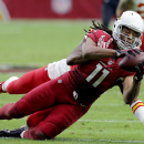 Arizona Cardinals wide receiver Larry Fitzgerald (11) makes a catch against the Kansas City Chiefs during the first half of an NFL football game, Sunday, Dec. 7, 2014, in Glendale, Ariz The Associated Press