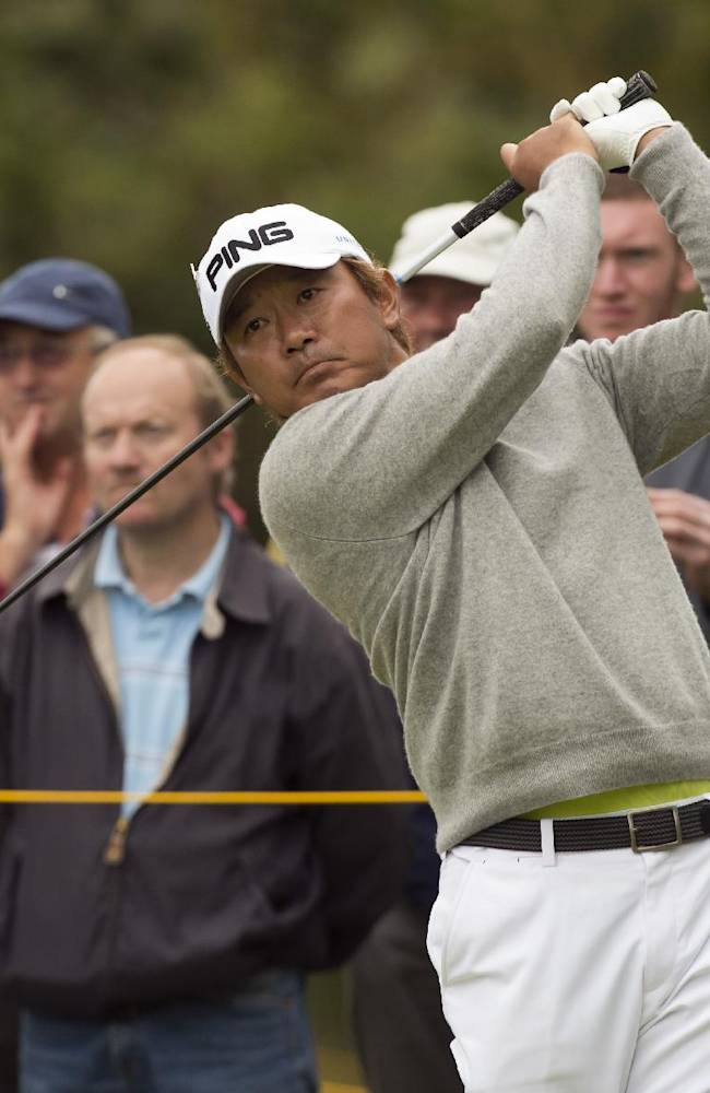 Yoshinobu Tsukada of Japan plays a shot from the 5th tee during a practice round at the Royal Liverpool Golf Club prior to the start of the British Open Golf Championship, in Hoylake, England, Monday, July 14, 2014. The 2014 Open Championship starts on Thursday, July 17