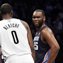 Charlotte Bobcats center Al Jefferson (25) reacts alongside Brooklyn Nets center Andray Blatche (0) in the second half of an NBA basketball game, Wednesday, Feb. 12, 2014, in New York. The Nets won 105-89 The Associated Press
