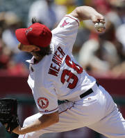 Los Angeles Angels starting pitcher Jered Weaver throws during the fourth inning of a baseball game against the Minnesota Twins on Wednesday, July 24, 2013, in Anaheim, Calif. (AP Photo/Jae C. Hong)