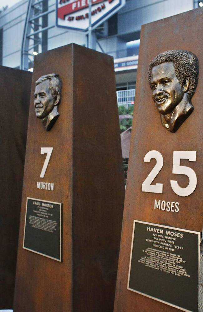 Former Denver Broncos wide receiver Haven Moses stands next to a pillar bearing his likeness, alongside those of other Bronco greats, at the unveiling ceremony for the Broncos Ring of Fame Plaza at Mile High Stadium in Denver, Friday Sept. 27, 2013