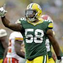 Green Bay Packers' Sam Barrington reacts after making a stop on special teams during the first half of an NFL football preseason game against the Kansas City Chiefs Thursday, Aug. 28, 2014, in Green Bay, Wis. (AP Photo/Tom Lynn)