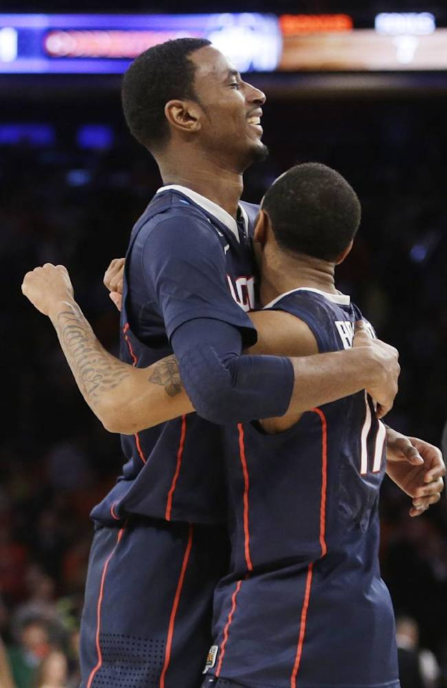 Connecticut's DeAndre Daniels, left, hugs teammate Ryan Boatright after Connecticut defeated Iowa State 81-76 in a regional semifinal of the NCAA men's college basketball tournament Friday, March 28, 2014, in New York