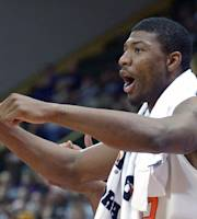 Oklahoma State's Marcus Smart celebrates from the bench during the second half of an NCAA college basketball game against Purdue in Kissimmee, Fla., Thursday, Nov. 28, 2013. (AP Photo/Phelan M. Ebenhack)