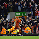 Liverpool's Dejan Lovren, centre, celebrates after scoring against Swansea during the English League Cup soccer match between Liverpool and Swansea at Anfield Stadium, Liverpool, England, Tuesday Oct. 28, 2014