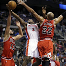 Detroit Pistons shooting guard Rodney Stuckey (3) shoots between Chicago Bulls center Joakim Noah (13) and forward Taj Gibson (22) during the second half of an NBA basketball game in Auburn Hills, Mich., Wednesday, Nov. 27, 2013 The Associated Press