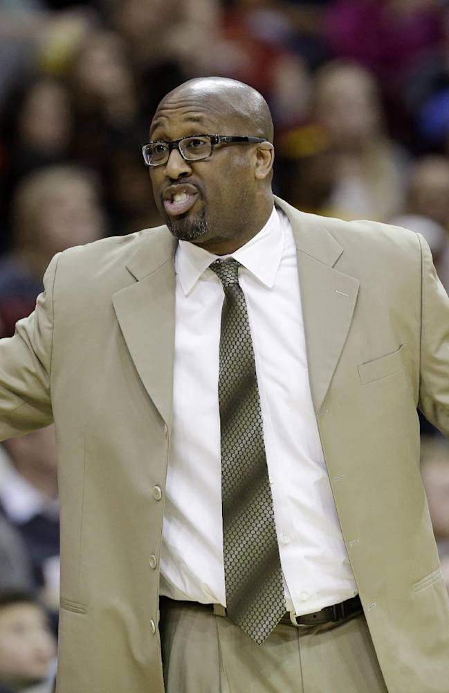 Cleveland Cavaliers coach Mike Brown reacts during the third quarter of an NBA basketball game against the Atlanta Hawks on Thursday, Dec. 26, 2013, in Cleveland. Atlanta defeated Cleveland 127-125 in double overtime