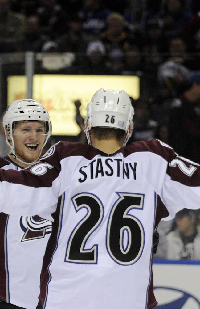 Colorado Avalanche left winger Gabriel Landeskog, left, celebrates a goal by center Paul Stastny (26) during the second period of an NHL hockey game against the Buffalo Sabres in Buffalo, N.Y., Saturday, Oct. 19, 2013