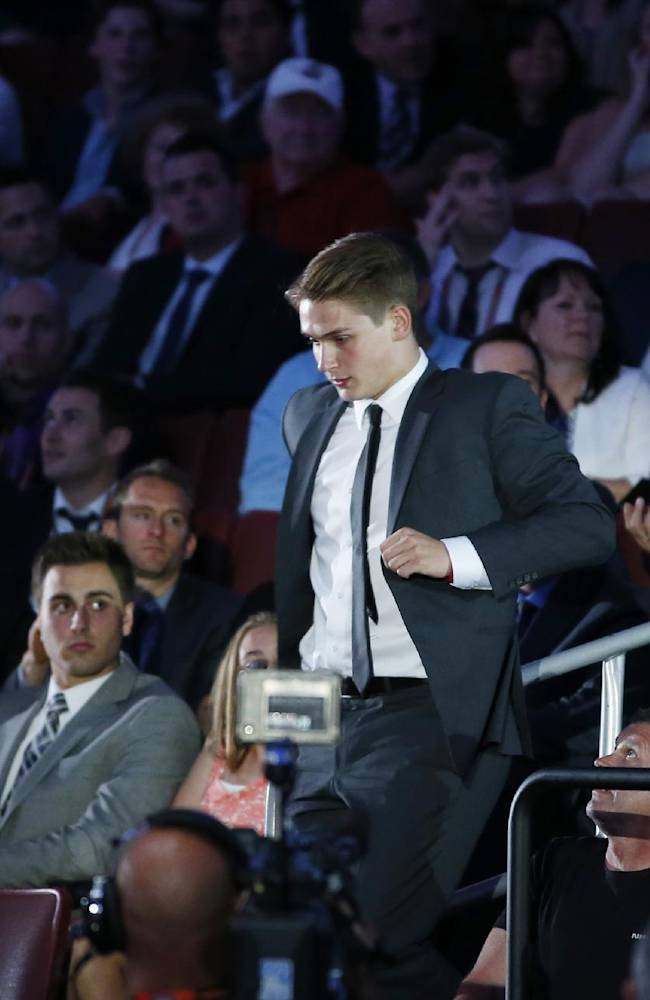 Jake Virtanen walks to the stage after being chosen sixth overall by the Vancouver Canucks during the first round of the NHL hockey draft, Friday, June 27, 2014, in Philadelphia